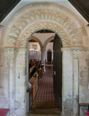 Decorated norman arch over the north door to All Saints Church, Compton